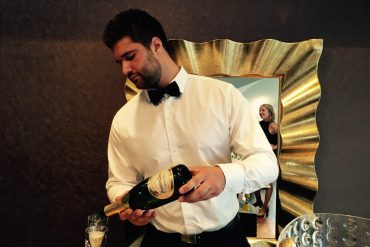 Sexy Butler serving Champagne